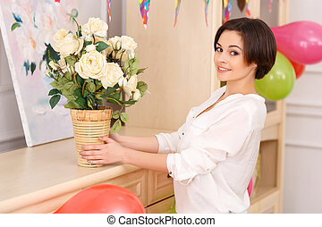 Young girl decorating her apartment for birthday party