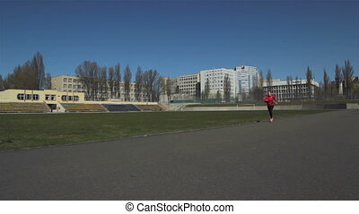 Young girl doing a race at the stadium.