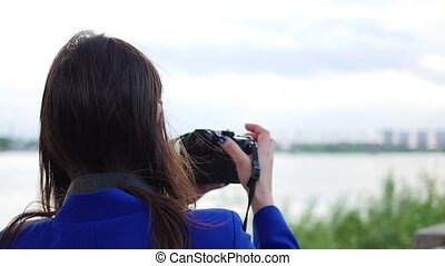 young girl doing a video on the camera. To pose for the camera. Fun outdoors