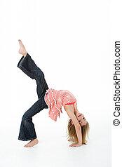 Young Girl Doing Backflip In Studio