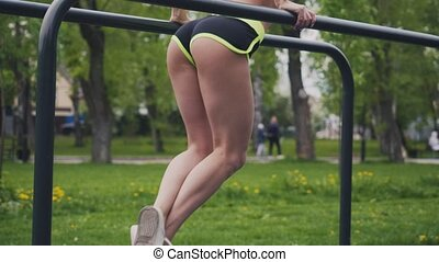 Young girl doing exercises outdoors - Young girl doing...