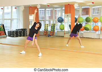 young girl doing fitness in the sport center