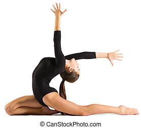 Young girl doing gymnastic exercises