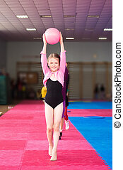 Young girl doing gymnastics exercise