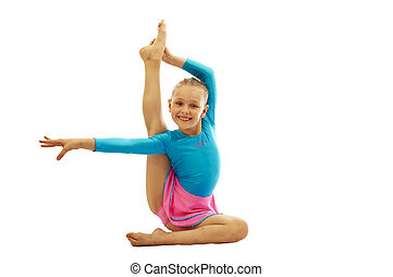 young girl doing gymnastics exercises - young smiling...