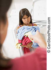 Young Girl Doing Laundry