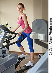 young girl doing step machine workout