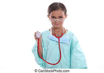 Young girl dressed up as a doctor