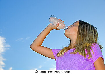 young girl drinking bottled water