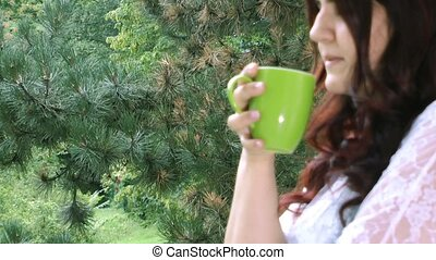 Young girl drinking coffee