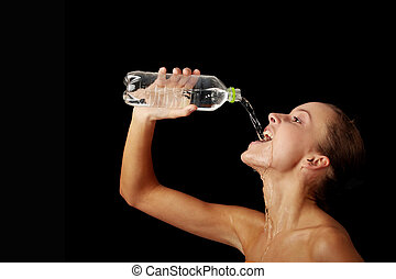 Young girl drinking water from a bottle