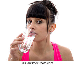 young girl drinks a glass of water, on white