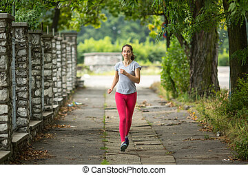 Young girl during a morning jog