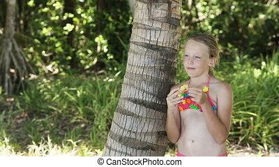 Young girl eating a banana fruit