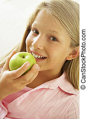 Young Girl Eating An Apple
