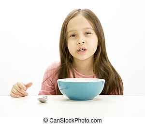 Young girl eating cereal