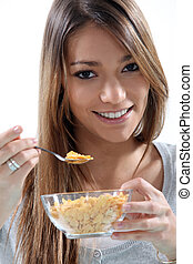 young girl eating cereals