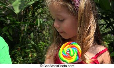 Young Girl Eating Lollipop