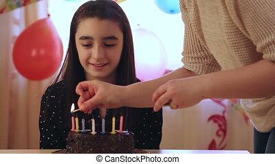 Young girl enjoying birthday cake