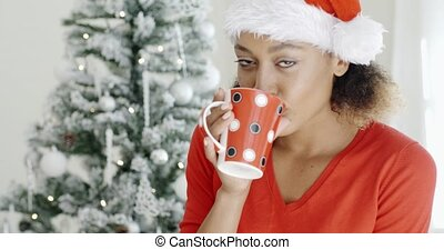 Young girl enjoying coffee on Christmas Day - Young girl...