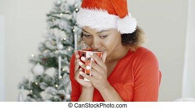Young girl enjoying coffee on Christmas Day - Young girl...