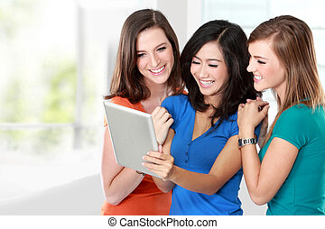 young girl friend using tablet together