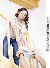 young girl furnishes the new home