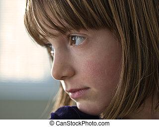 Young girl gazing.