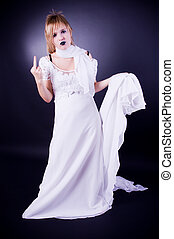 Young girl gesticulating - Young girl in white dress ...