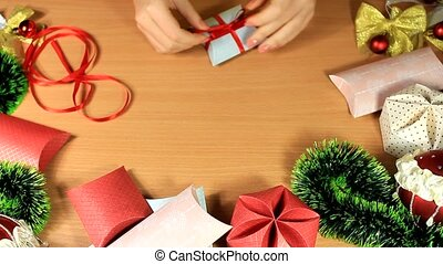 young girl gives a gift a small box