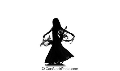 Young girl go on dancing belly dance with shawl, sihouette, on white background, slow motion