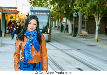 Young girl goes on a trip expected the tram