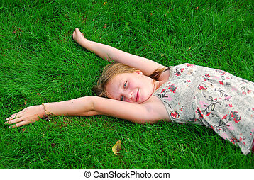 Young girl grass