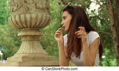 young girl hair straightens up and licks lollipop