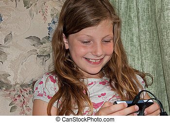 Young Girl Happy Playing Video Game