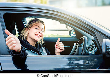 Young girl happy seated in her new car