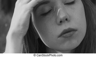 young girl has a headache - A young beautiful girl has a...