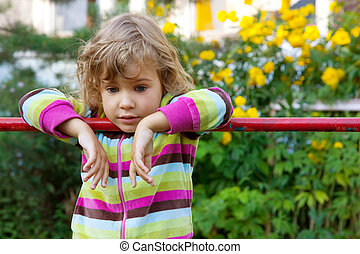 young girl has a rest in backyard
