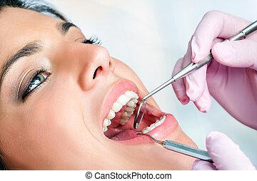 Young girl having dental check up - Macro close up of woman ...
