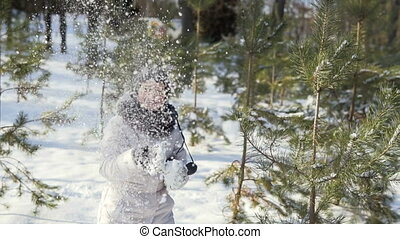 Young Girl Having Fun with Snowballs in Park
