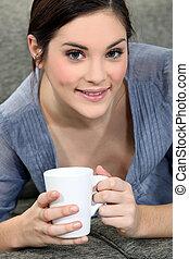 young girl having tea