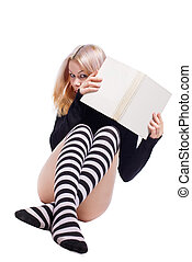 Young girl hide on book - Young girl in striped socks hide...
