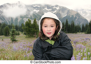 Young Girl hiking outdoors during early spring in the mountains