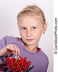 Young girl holding a bunch of viburnum