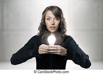 Young girl holding a light bulb