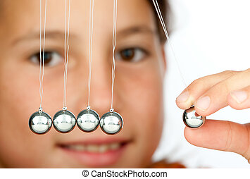 holding a pendulum ball - young girl holding a pendulum ball