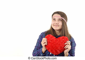 young girl holding a red heart