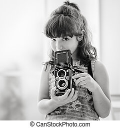Young girl holding a vintage camera - Cute photographer girl...