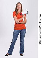 Young girl holding bullhorn