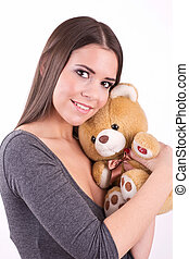 Young girl hugging a teddy bear